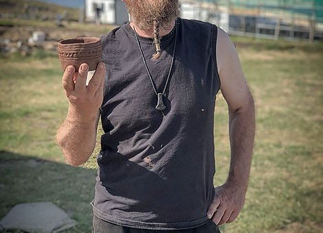 Dr Mike Copper with a pot created by one of this afternoon's pottery workshop participants at the Ness.