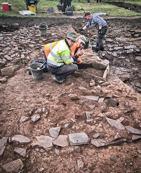 Trench supervisors Paul and Colin at work on the Trench J extension hearth this afternoon.