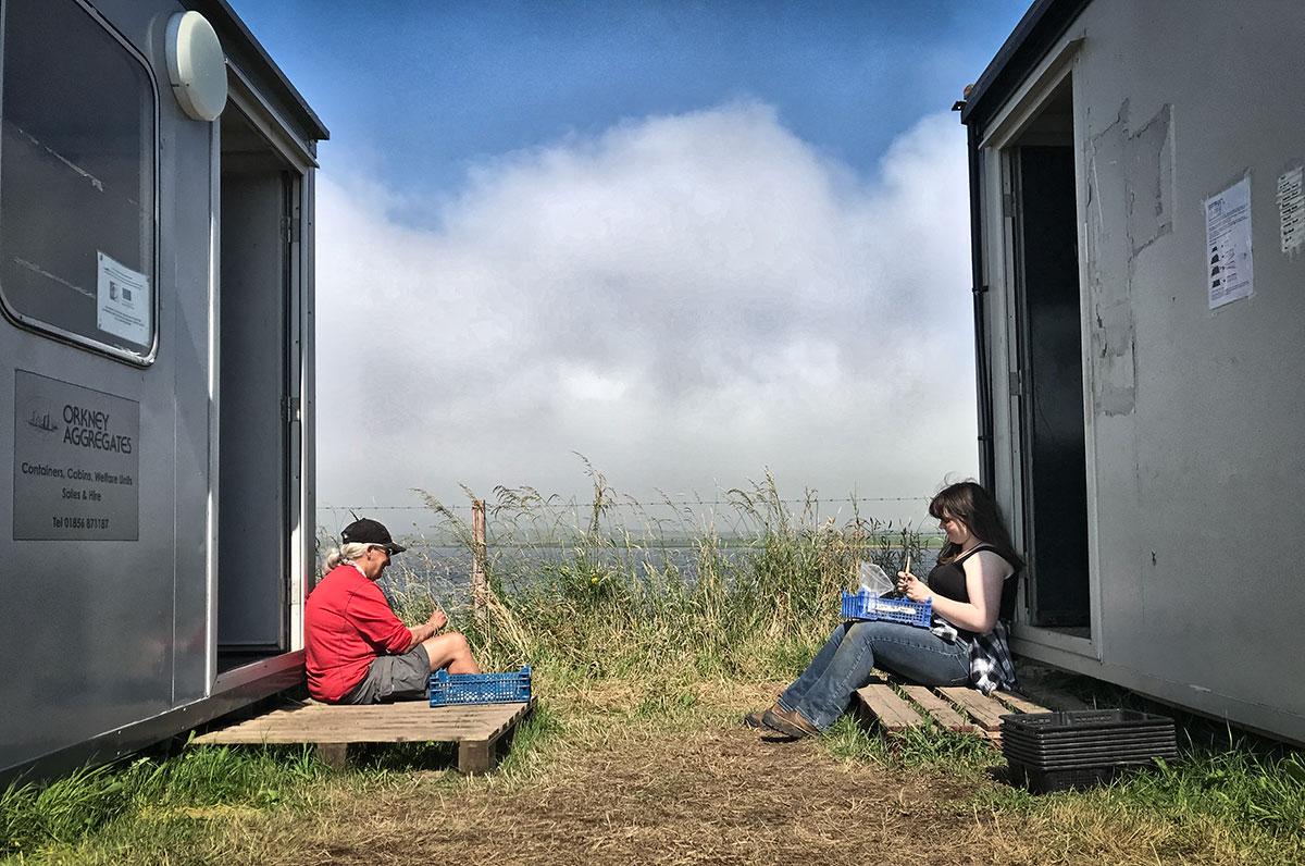Between the huts. Megan and Kate.