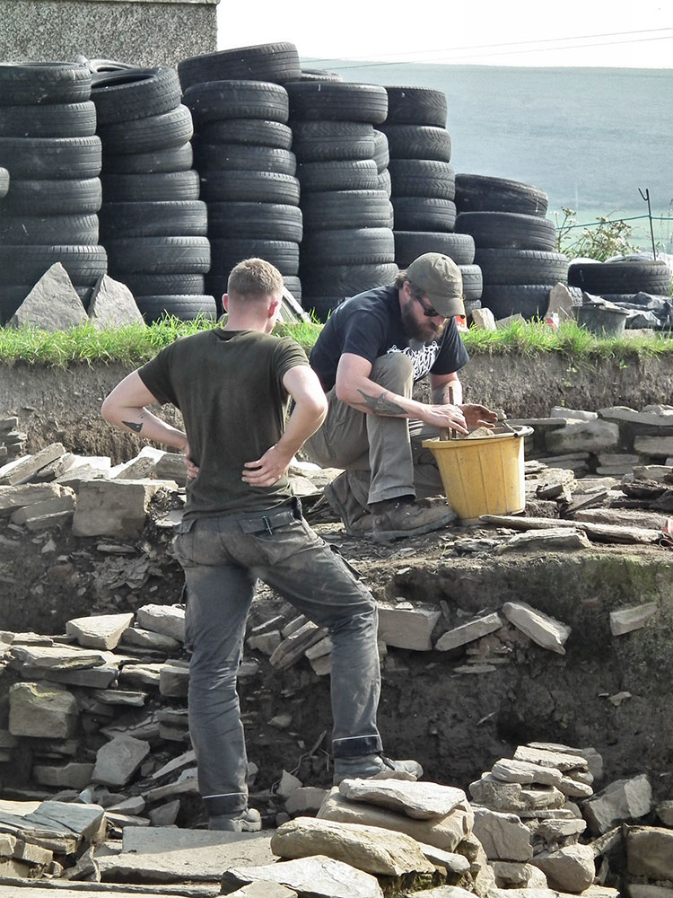 Andy and Declan removing rubble from the 'central midden area'