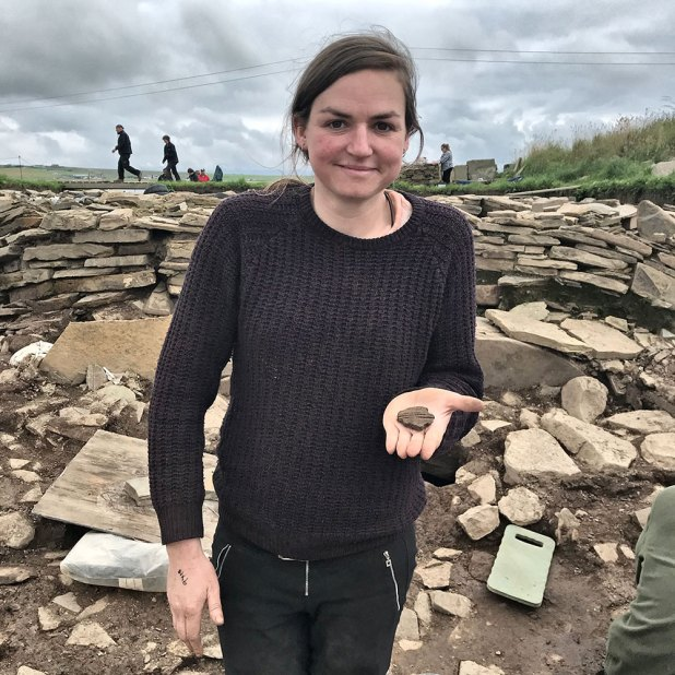 Catherine, from Structure Eight, with a fine piece of Grooved Ware pottery found in the central midden area.