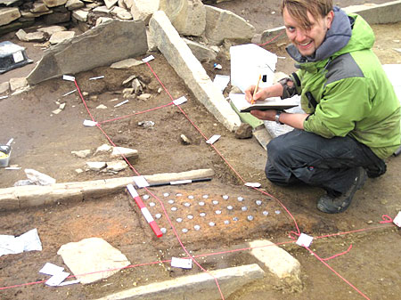 Sam hard at work taking his 'button' samples from one of the Structure Eight hearths.