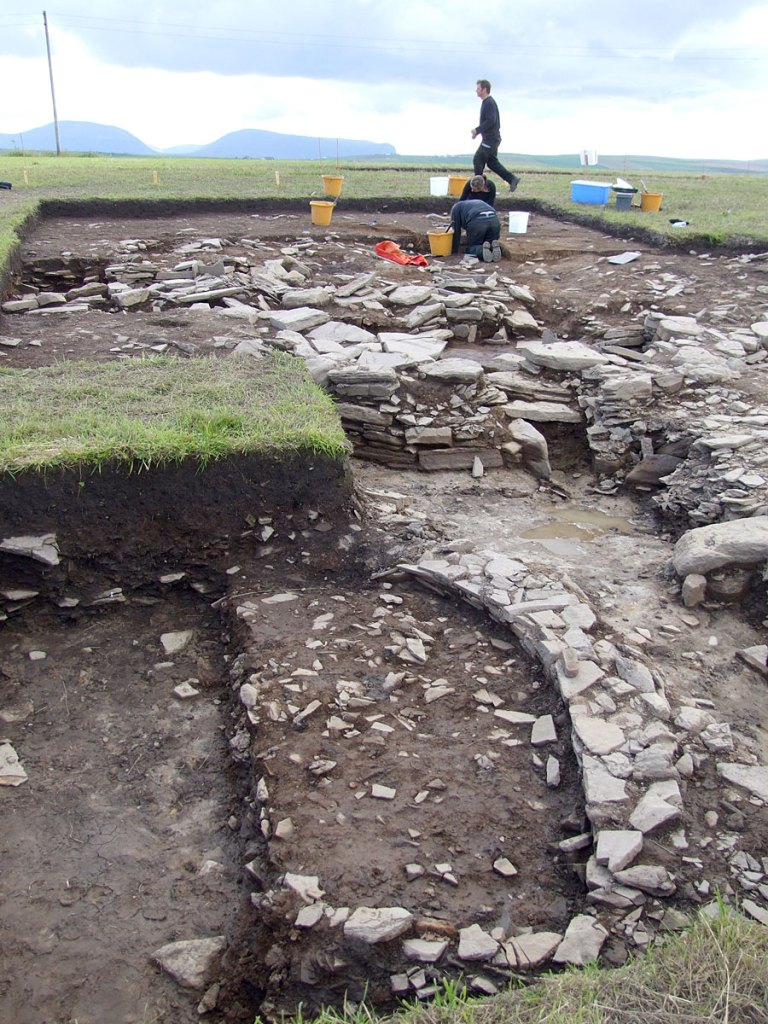 Later wall lines in Trench J, with the northern end of Structure Five in the middle ground.