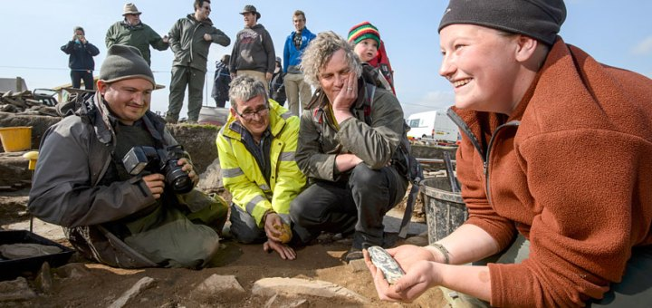 A delighted Jo in 2012 with one of the most stunning polished stone axeheads found at the Ness to date. (Jim Richardson)