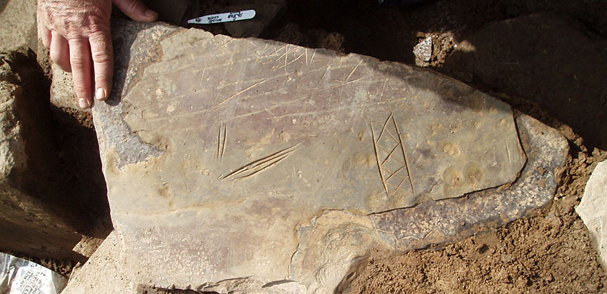 2013: The second incised stone recovered from beneath Structure Ten's south-western buttress. (ORCA)