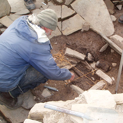 2013: Mic excavates the cist in the Structure Twelve northern annexe. (ORCA)