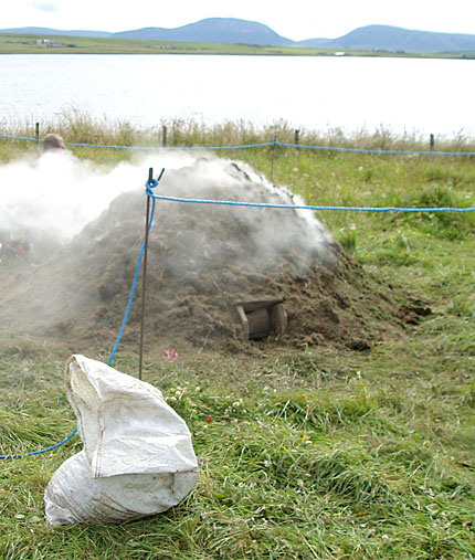 An experimental pottery firing on site in 2012. (ORCA)