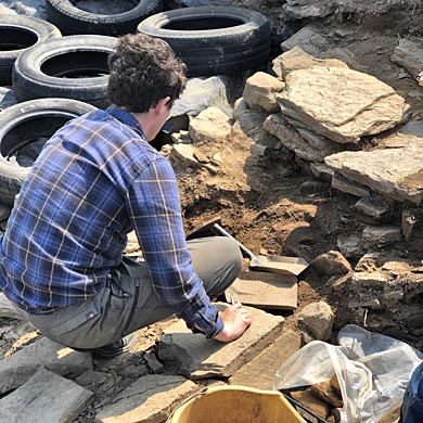 Duncan removing the ephemeral later wall west of Structure Thirty-Two. (Sigurd Towrie)