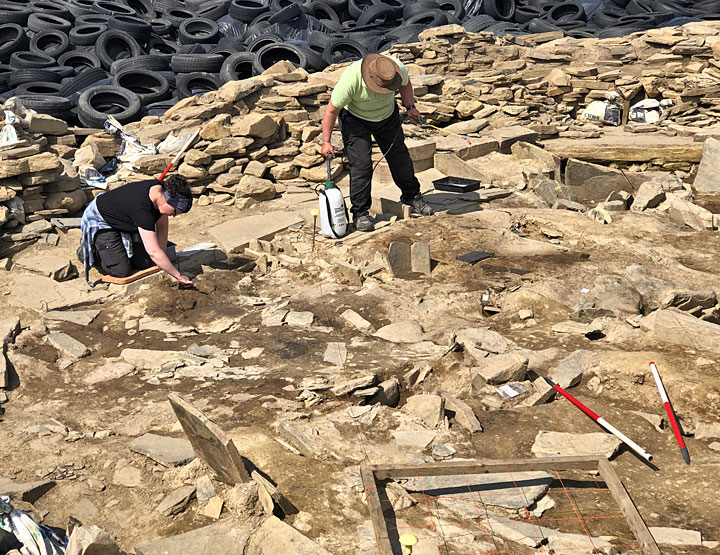 Mandy preparing to lift her pottery sherds while Jem dampens down the floors of Structure Ten ahead of cleaning. (Sigurd Towrie)