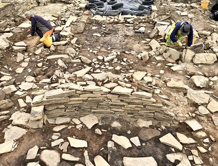 Colin and Ray excavating within Structure Five's central area, with the later Structure Thirty-Two in the foreground. (Sigurd Towrie)