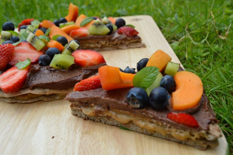 healthy dessert pizza with caramel oozing out