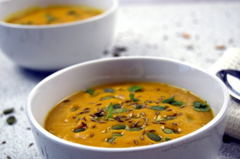 A bowl of roasted butternut squash soup with almond butter