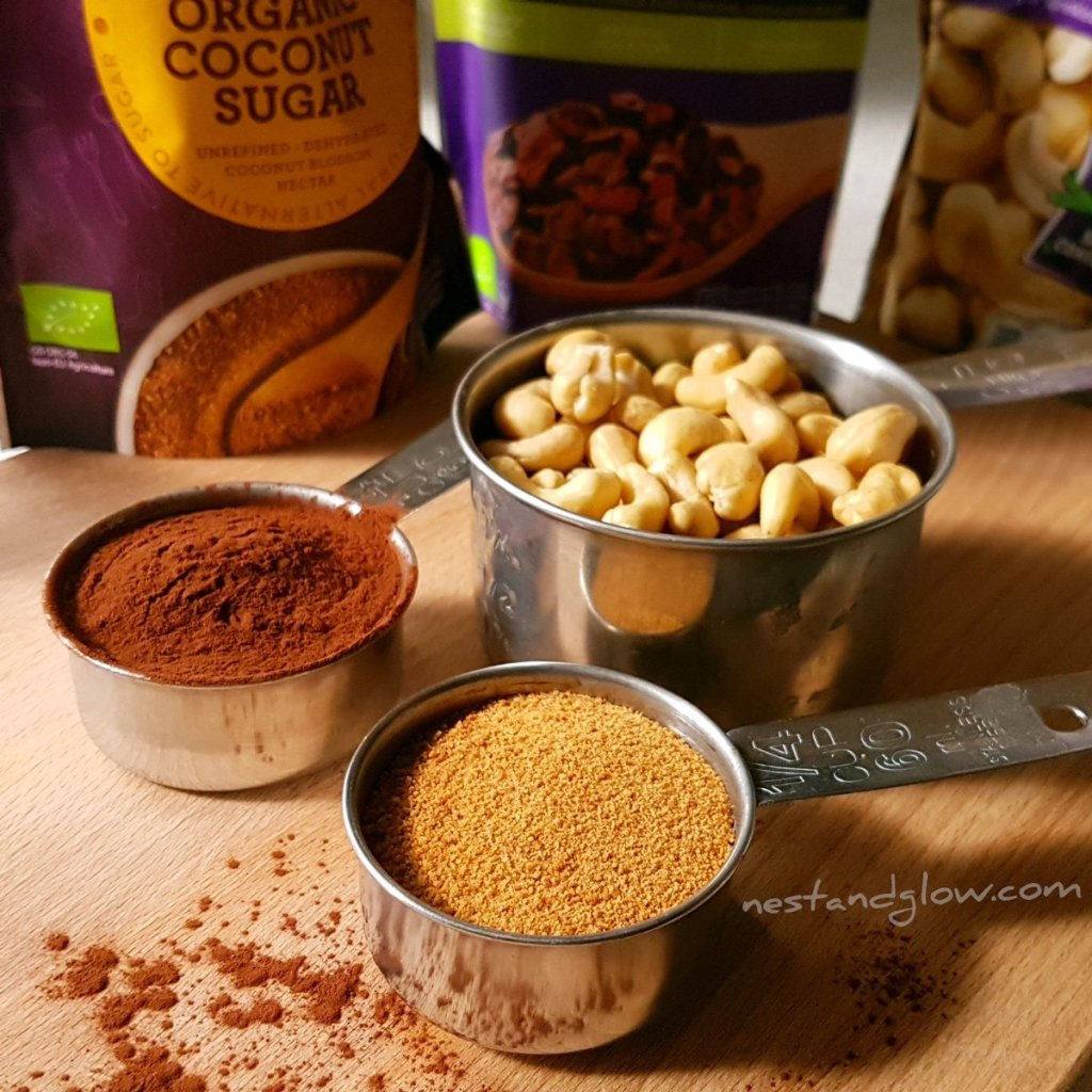 The three ingredients for cacao dusted cashew nuts - cacao, coconut sugar and cashew nuts
