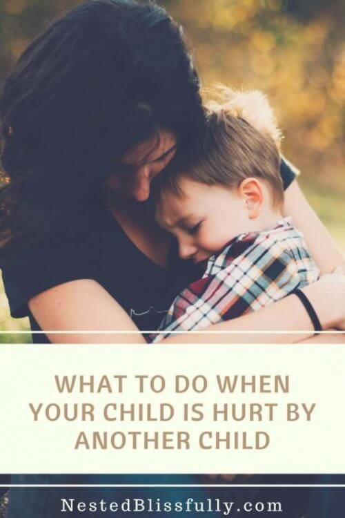Mother comforting her hurt hurt child because he was pushed