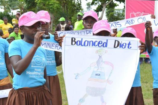 World Heart Day- balanced diet slogan held by kids in a rally