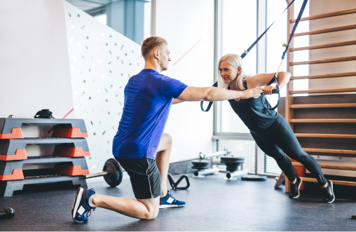 Male with Personal Trainer Certification working with woman