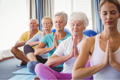 A group of seniors practicing yoga