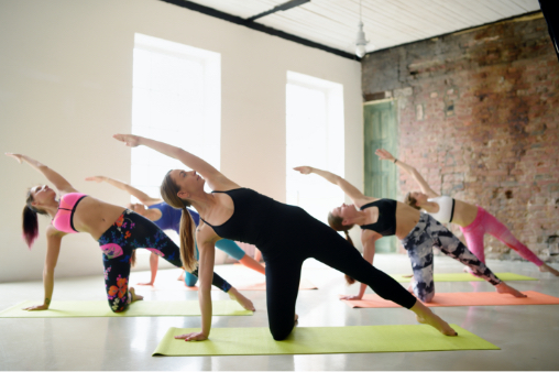 A group of women at a yoga studio