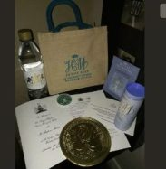 A bottle of water among other items in Royal Wedding Gift Bag