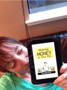 April Karys holding Making Money In Your PJs, freelancing for voice-overs and other solopreneurs by Paul Strikwerda