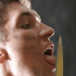 Nethervoice Man Licking A Knife