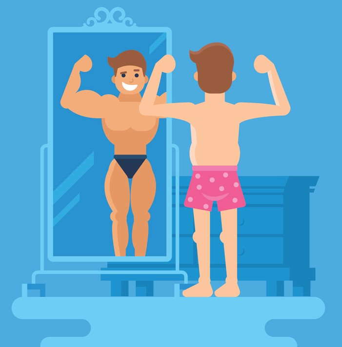 man standing at the mirror