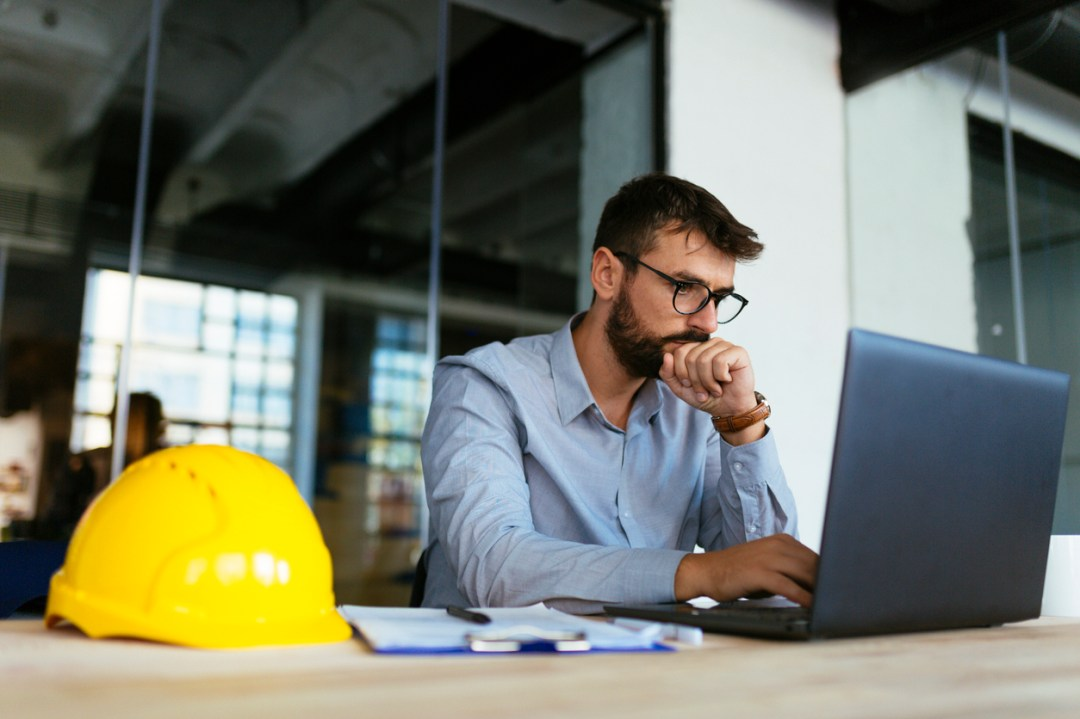 Contractor examines his construction company website