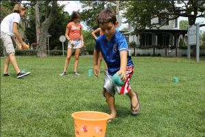 Children playing outdoor yard games