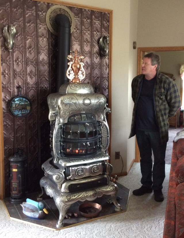 Brian and a vintage stove in his home.
