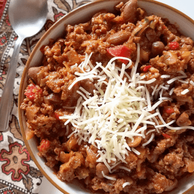 """This red chili is made with roasted red peppers instead of tomatoes, giving it a slightly different and wonderful flavor! In addition to being tomato-free (""""nomato""""), it's also gluten-free, has a lot of veggies hidden in it and can easily be made Paleo and Whole30 compliant. It's so good it'll be the only red chili you make!"""