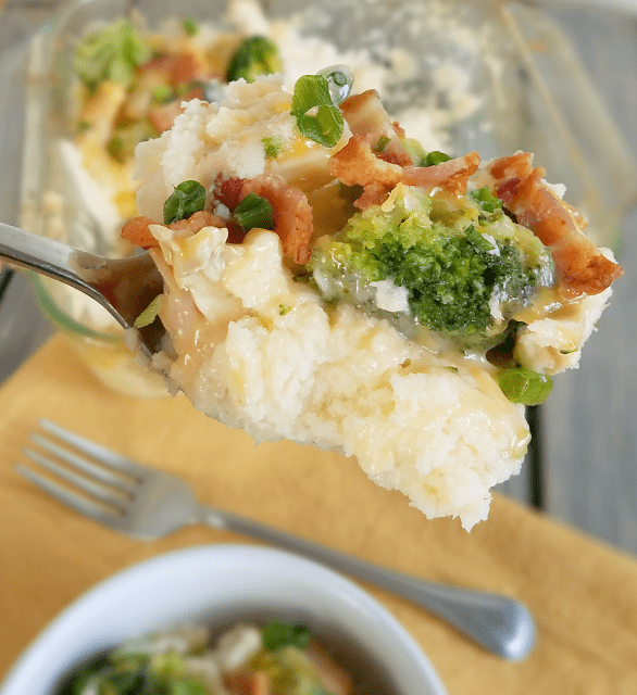This complete meal includes creamy mashed cauliflower topped with chicken, cheese, bacon, broccoli and scallions for a delicious and filling meal!