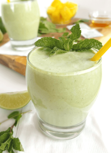 This Matcha Green Tea Smoothie has been taken to the next level with pineapple, lime and mint! All of those fun flavors hide spinach, making this matcha green tea smoothie super nutritious, Paleo and vegan as well as refreshing and delicious.