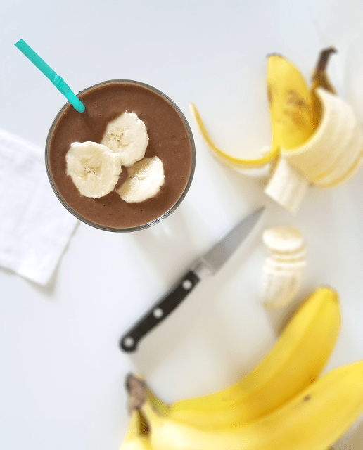This Chocolate Peanut Butter Banana Smoothie with Coffee makes the perfect breakfast on the go! With plenty of protein, fiber, nutrients and a little boost from the coffee, this shake will start your day right and keep you going all morning. Use sunflower seed butter instead of peanut butter to make it Paleo!