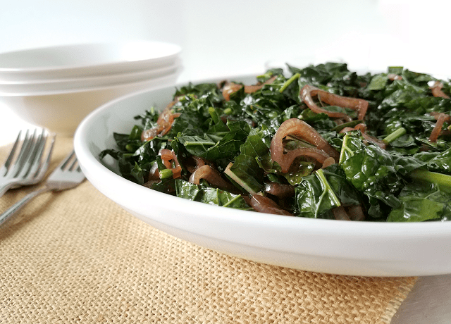 Sauteed Kale with Balsamic Glazed Shallots by Taste Abounds