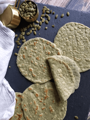 These Grain Free Pumpkin Seed Flour Tortillas are just as pliable, nutritious and delicious as my original grain-free almond flour tortillas, but ground pumpkin seeds instead of almond flour makes them nut-free as well as gluten-free, grain-free, vegan and Paleo. They're also easy to make and only require four ingredients. Time to conquer taco night!