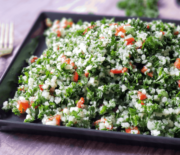 close up picture of cauliflower tabbouleh a.k.a. tabouli salad with roasted red peppers instead of tomatoes