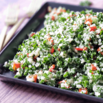 cauliflower tabbouleh a.k.a. tabouli salad on a plate with forks next to it