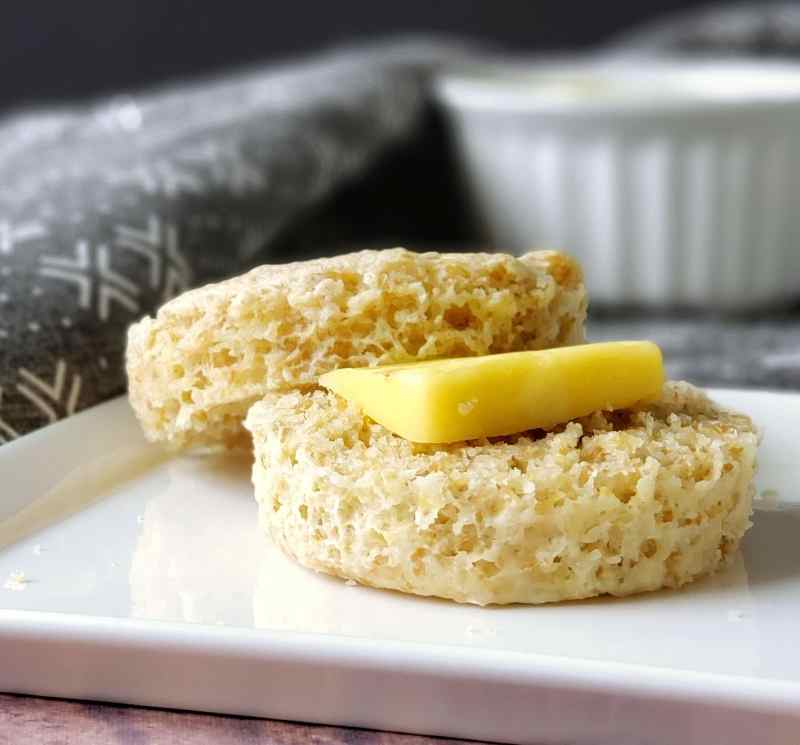 up close photo of a biscuit or english muffin with butter