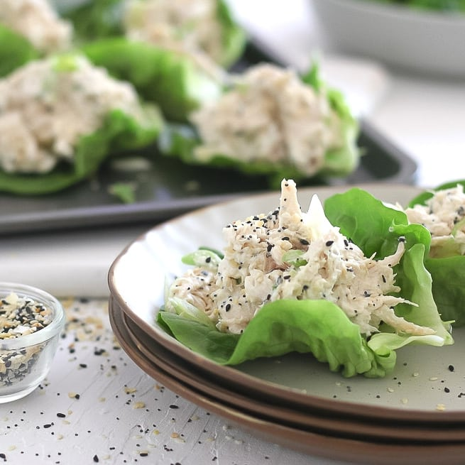 creamy chicken salad sprinkled in everything bagel seasoning in a lettuce cup on a plate