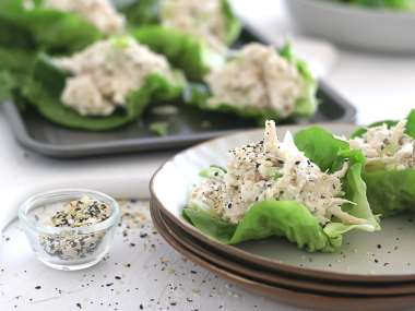 creamy chicken salad flavored with everything bagel seasoning in a lettuce cup on a plate