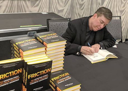 Roger Dooley signing copies of Friction in person