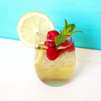 Raspberry Lemonade Spritzer - Refreshing, cool, and for adults only. This simple no-frills classic is meant for any mom or parent who wants to enjoy some down time with a tasty, fruity, alcoholic beverage! NeuroticMommy.com #momlife #vegan