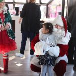 Santa Claus takes a break during his busiest time of year and returns to the Lake Las Vegas community to cruise on the lake with children.