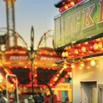 """Carnival at dusk. NAIOP Southern Nevada's Bus Tour Committee is pleased to present the 2017 """"Greatest Show on Earth"""" Bus Tour Event."""