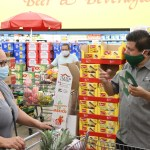 North Las Vegas Mayor Pro Tem Isaac Barron gives masks to customers at the La Bonita Supermarket.IMG_5041