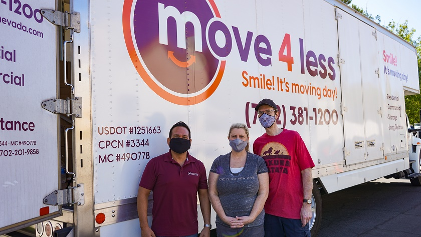 Eyrick Gibson of Move 4 Less (left) with Moving Our Community recipients Michelle and Brian Mell sm-9f759b79
