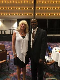 Council Executive Director Sherry Manning posing next to AIDD former Commissioner Aaron Lewis at the 2015 Nevada Disabilities Conference