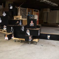 The Dark Side of Mount Rushmore // Wood, Pallet, Screws, Cardboard Boxes, Acrylic Paint, Digital Prints, Trolley Wheels // 400 x 200 250 cm // 2010