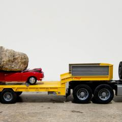 Guggenheim Globetrotters World Tour: Venezuela // Toy truck, car and rock // 10 x 29 x 12 inches // 2011