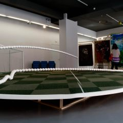 360 Degree Action Replay: 1/3 scale model for a proposed public sculpture commission 1997-2012 // Wood, Steel, Carpet Tiles, Styrofoam Balls, Netting, Screws, Bolts, Seating, Acrylic Paint, Nylon Cord // 6 x 6 x 1.2 m // 2012
